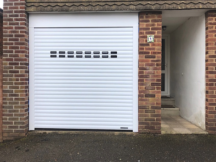 Window slotted electric roller shutter installed in Bournemouth